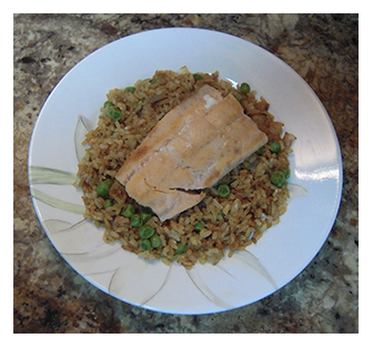Grilled salmon filet on brown rice